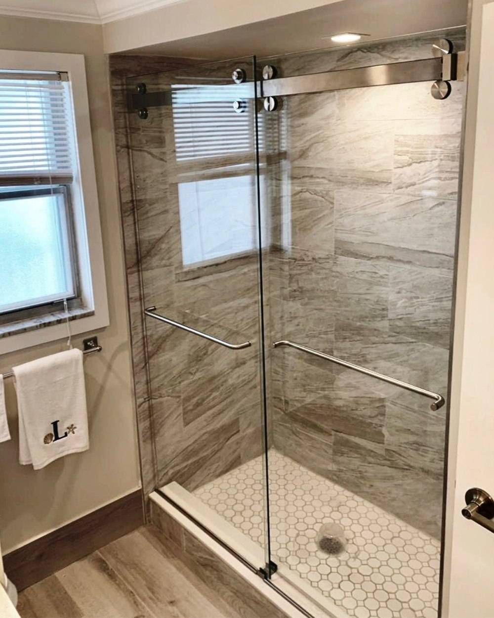 The Original Frameless Shower Doors Introduces Swinging Shower Doors