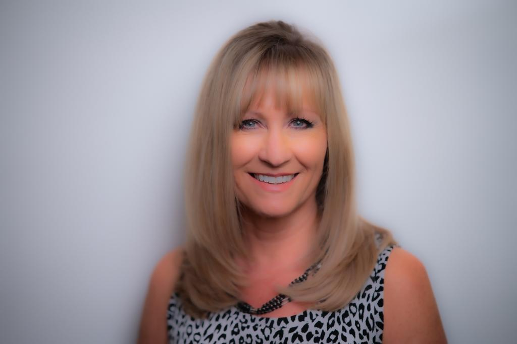 How Tami Holmes Built a Successful Real Estate Business by Continually Adapting